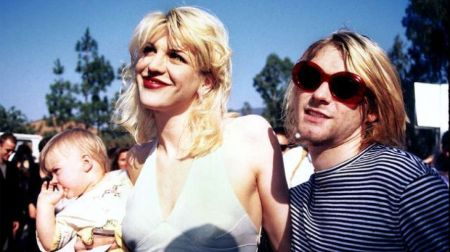 Kurt Cobain with his wife Courtney and baby Frances.